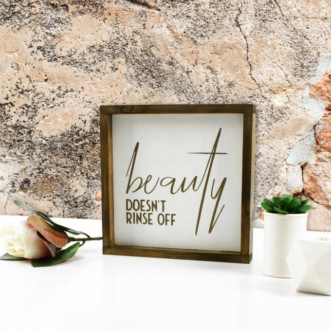 Beautifully crafted with a gorgeous message, a framed timber 'Beauty Doesn't Rinse Off' sign made by Phoenix & Arrow